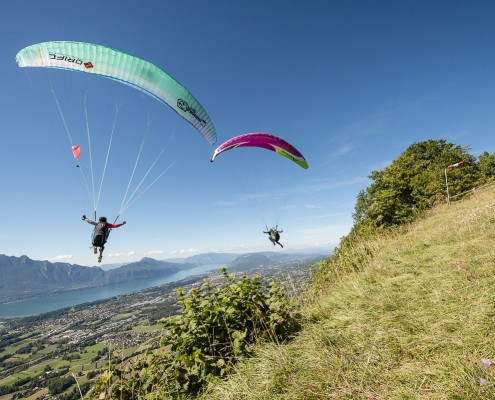 Chambery France (73), August 28, 2014: training above Lake du Bourget for the french paragliding aerobatic championship