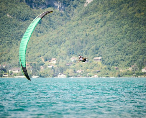 Lake Annecy France, August 28, 2014: french paragliding aerobatic championship - Philippe Périé