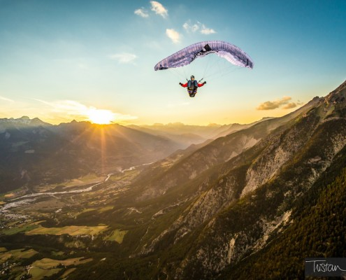 © www.TristanShu.com High up in the air, the Alps, a sunset and a full stall glider with Jean Baptiste Chandelier
